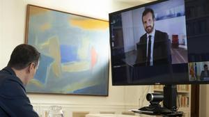 Pedro Sánchez y Pablo Casado, el pasado lunes, durante su reunión por videoconferencia.
