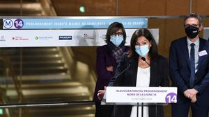 Paris  mayor Anne Hidalgo delivers a speech during the inauguration of the extension of the metro line number 14  in Saint-Ouen on December 14  2020  (Photo by Alain JOCARD   AFP)