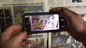Una 'app' permite ver los contenidos multimedia acercando el móvil a unos códigos que aparecen en la versión impresa del diario