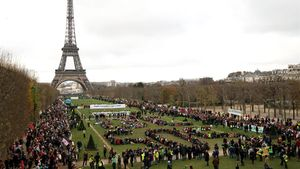 TO GO WITH AFP PACKAGE   Fifth anniversary of Paris Agreement on climate change -(FILES) In this file photo taken on December 12  2015 Several Non Governmental Organisations (NGO) gather to form a human chain  reading   3 C SOS  on the Champs de Mars near the Eiffel Tower in Paris on the sidelines of the COP21  the UN conference on global warming  (Photo by ALAIN JOCARD   AFP)