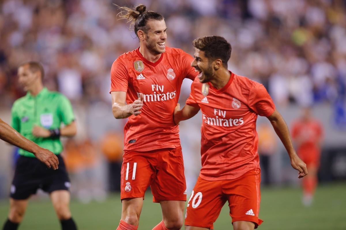 Bale (i) y Asensio celebran uno de los goles ante la Roma.
