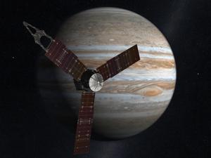 Representación artística de la nave espacial 'Juno' de la NASA, haciendo uno de sus viajes cerca a Júpiter.