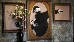 HEB01. Bethlehem (---), 04/03/2017.- An artworks of British street artist Banksy is displayed in the Walled Off Hotel in the West Bank city of Bethlehem, 04 March 2017. The hotel in the Palestinian territories is placed only a couple of meters from Israel's separation wall with all rooms facing it. The Walled Off Hotel will open for guests on 20 March, with bookings via the website. EFE/EPA/ABED AL HASHLAMOUN