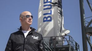 This April 24, 2015 handout photograph obtained courtesy of Blue Origin shows Jeff Bezos, founder of Blue Origin, at New Shepard's West Texas launch facility before the rocket's maiden voyage.