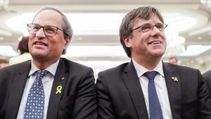 El 'president' del Govern, Quim Torra, y el expresidente Carles Puigdemont.