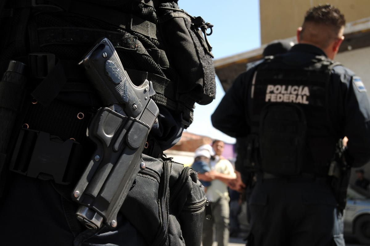 Cierre de una pistola de la policía federal mexicana.