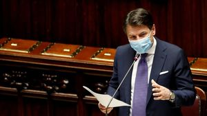 FILE PHOTO  Italian Prime Minister Giuseppe Conte addresses the lower house of parliament during a session on the coronavirus disease  in Rome  Italy  November 2  2020  REUTERS Remo Casilli File Photo