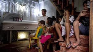 Una familia vela a una de las víctimas de la guerra contra la droga.