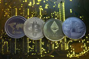Representaciones de las monedas virtuales Ripple, Bitcóin, Etherum y Litecoin.