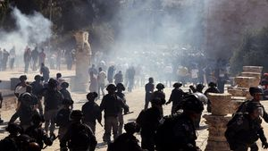 Smoke is seen after sound grenades exploded as Israeli police clash with Palestinian worshippers on the compound known to Muslims as Noble Sanctuary and to Jews as Temple Mount as Muslims mark Eid al-Adha in Jerusalem s Old City August 11  2019  REUTERS Ammar Awad