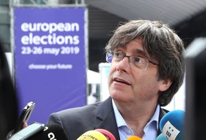 Former Catalan President Carles Puigdemont talks to the media during European Parliament Elections, outside EU Parliament, in Brussels, Belgium May 26, 2019.  REUTERS/Yves Herman
