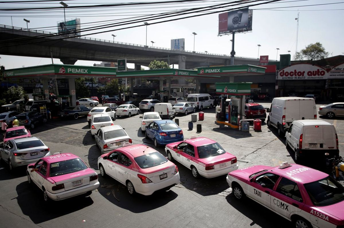 Cars are seen lined-up to buy fuel at a gas station in Mexico CityMexicoREUTERS Daniel Becerril