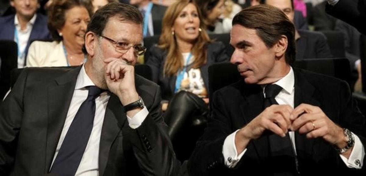 Mariano Rajoy y José María Aznar, en una imagen de la convención del PP del 2005.