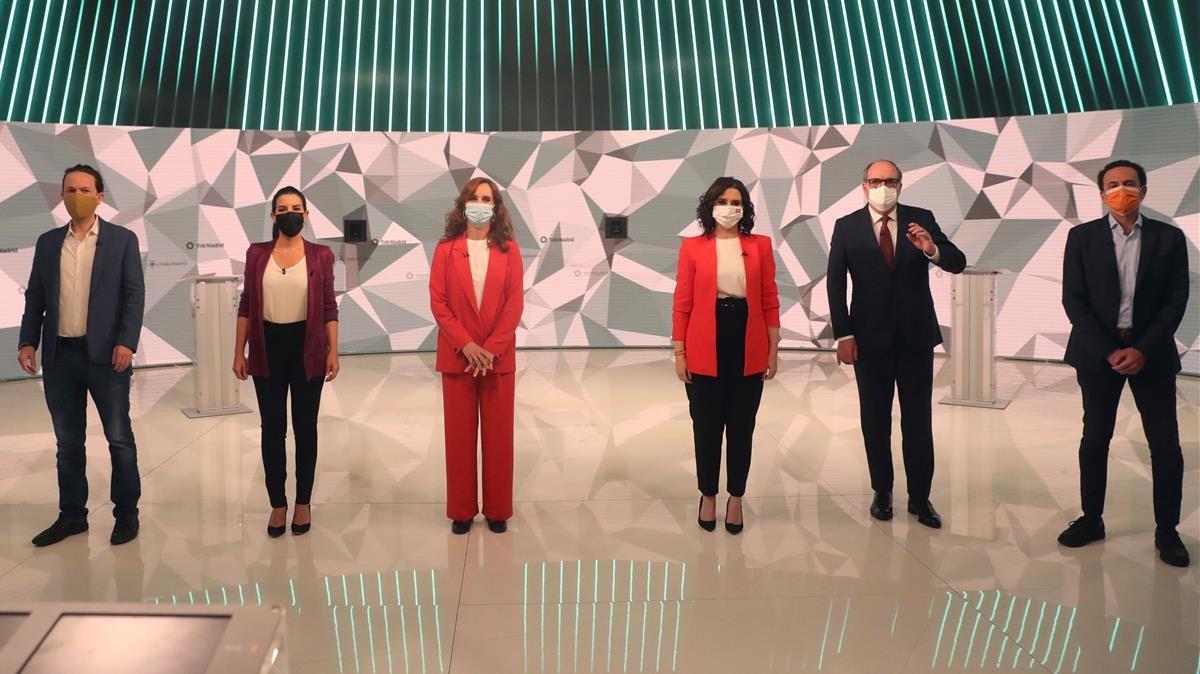 Los candidatos a la presidencia de la Comunidad de Madrid antes del inicio del debate que se celebra hoy miércoles en los estudios de Telemadrid.