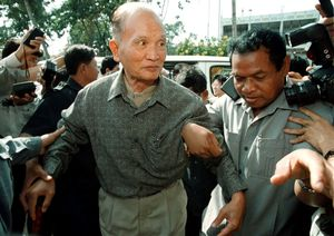 FILE PHOTO: A frail Nuon Chea, the late Pol Pot's brother number two, arrives at a Phnom Penh hotel after meeting with Cambodia's Prime Minister Hun Sen December 29, 1998.  REUTERS/File Photo
