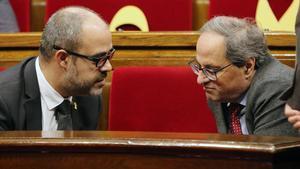 El 'conseller' Buch y el 'president' Torra, en el Parlament, en enero de este año.