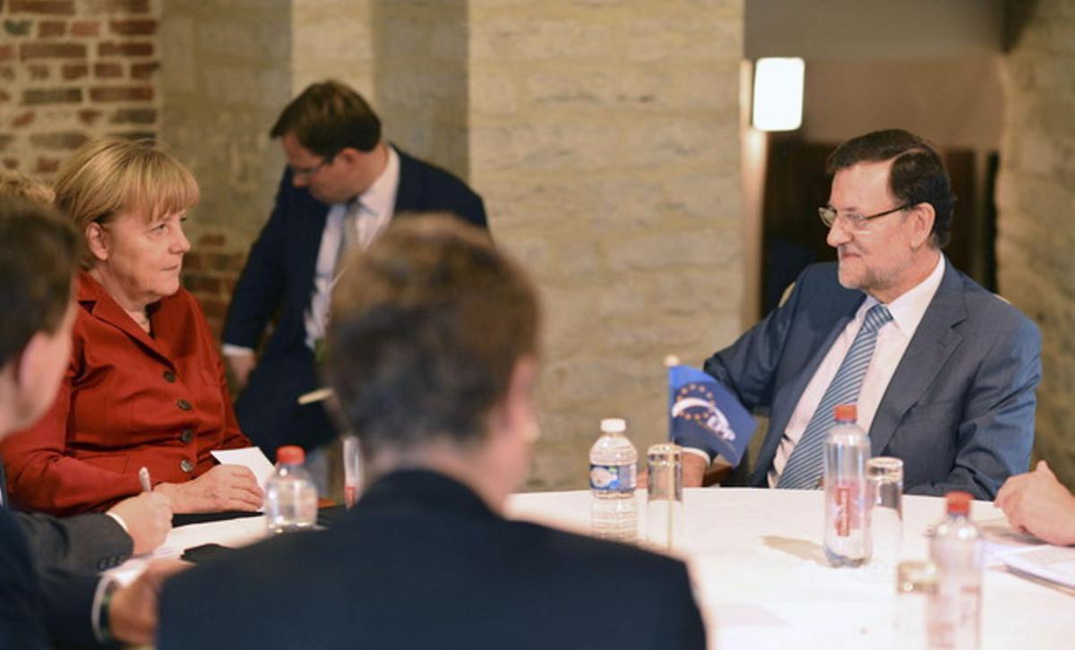 Mariano Rajoy, durante una reunión con Angela Merkel, el jueves en Bruselas.