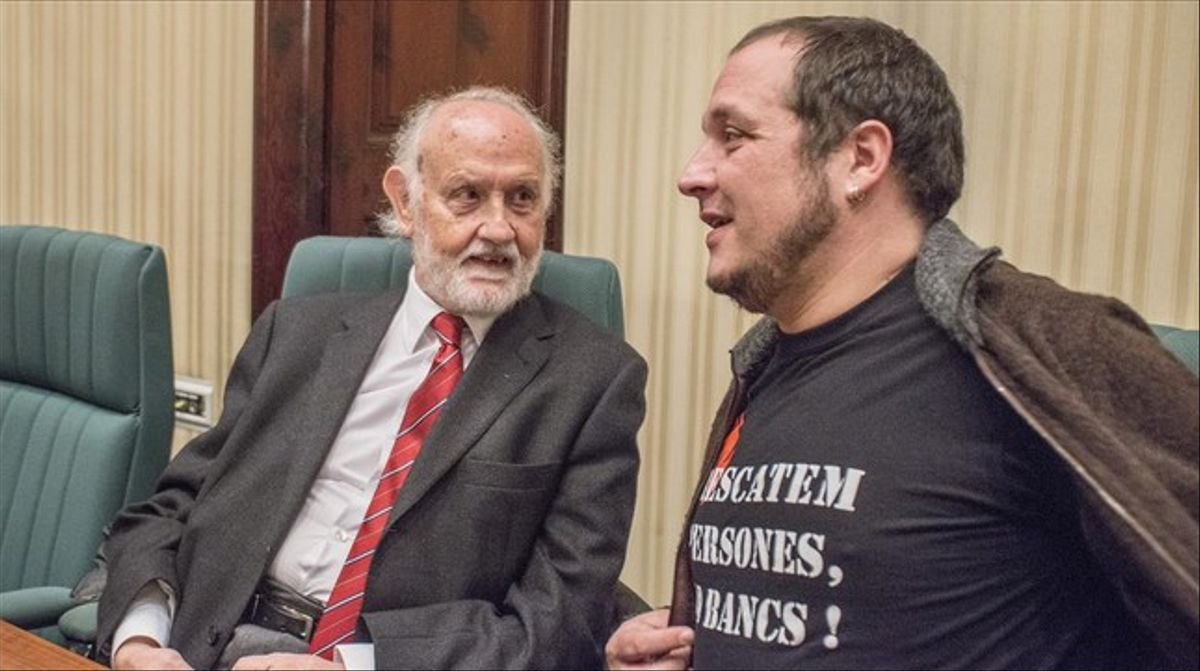 José María Mena, exfiscal jefe de Catalunya, junto a David Fernàndez