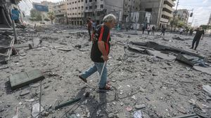 12 May 2021  Palestinian Territories  Gaza City  Palestinians inspect the severely damaged Al-Jawhara Tower area in Gaza City after it was hit by Israeli airstrikes amid the escalating flare-up of Israeli-Palestinian violence  The Health Ministry in the Hamas-run Gaza Strip said the number of Palestinians killed has risen to 35  including 12 children  while 233 people were reported injured  Photo  Mohammed Talatene dpa  12 05 2021 ONLY FOR USE IN SPAIN