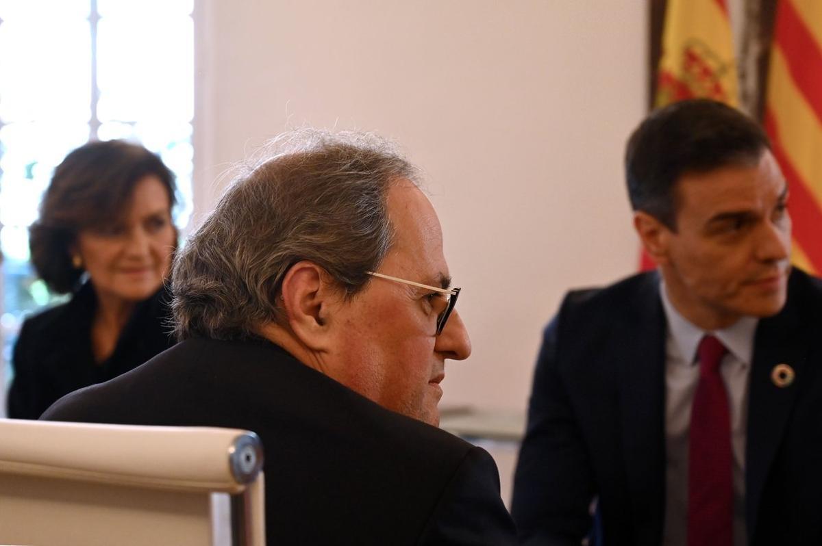 Sánchez, Torra y Calvo, en la reunión de Moncloa, ayer.