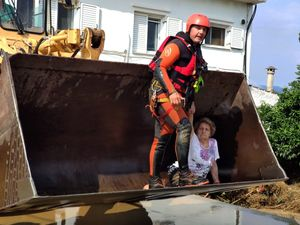 Evia Island (Greece), 09/08/2020.- A rescue team uses an excavator to remove an elderly woman from her flooded house, after a rainstorm hit the area of Mourtzi, on Evia Island, Greece, 09 August 2020. Three people died after a rainstorm struck many regions on Evia island on 08 August 2020. The victims include an 8 months old infant and the other two are an 86-year-old man and an 85-year old woman that were trapped in their flooded home. A total of 31 fire engines with an 83-member crew, a group of firemen on foot, 3 rescue vessels are operating in the flooded areas along with two helicopters and air rescuers. The fire brigade announced that they have already rescued 35 people who are now transferred to a safe place. (Incendio, Grecia) EFE/EPA/PANAGIOTIS KOUROS