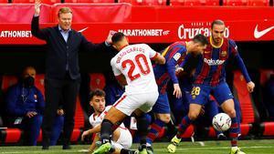 Messi y Mingueza, en Sevilla ante Munir y Diogo Carlos, en el duelo liguero del Sánchez Pizjuán.