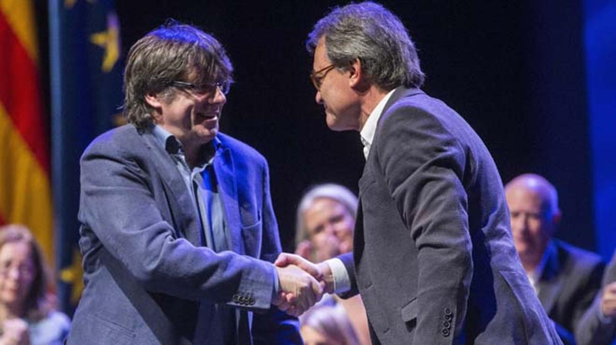 Carles Puigdemont y Artur Mas durante la primera conferencia ideológica celebrada por el partido.