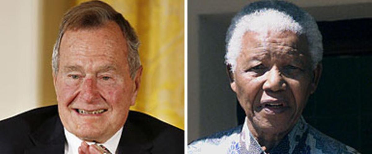 El expresidente de EEUU George Bush (izquierda) y el expresidente surafricano Nelson Mandela.
