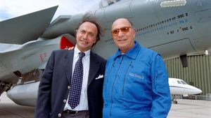(FILES) In this file photo taken on June 11  1997 Serge Dassault (R)  Dassault Group CEO  poses with his son Olivier Dassault in front of a Rafale M01 jet fighter in Le Bourget  near Paris  - Olivier Dassault has died in the crash of his helicopter near Deauville  a parlamentiary source said on March 7  2021  (Photo by Jack GUEZ   AFP)
