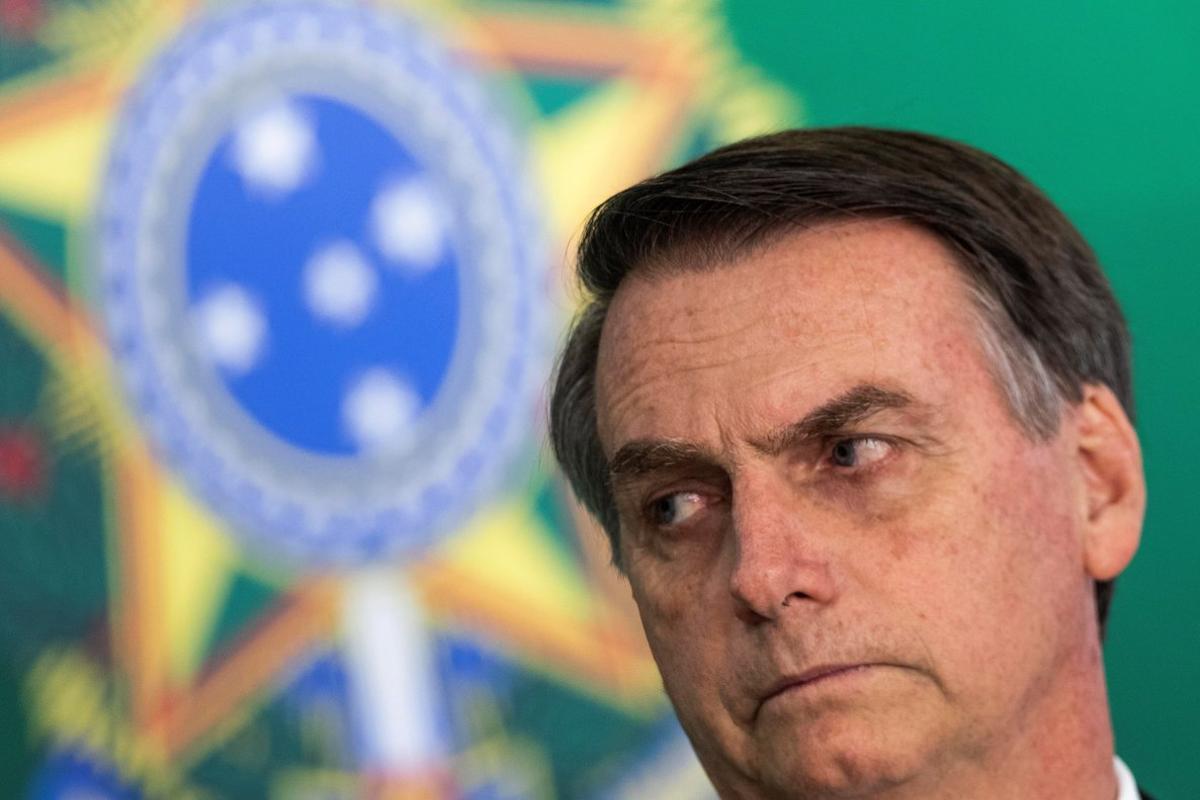 El presidente electo de Brasil Jair Bolsonaro y el actual mandatario Michel Temer fuera de cuadro ofrecen una declaracion conjunta en el Palacio del Planalto sede del Gobierno.
