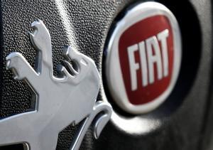 Logos of Peugeot and Fiat are seen in this illustration picture taken October 30, 2019. REUTERS/Regis Duvignau/Illustration