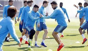 Messi y Suárez, en primertérmino, en el entrenamiento del Barça.