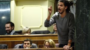 Podemos  We Can  party deputy Alberto Rodriguez gestures while taking an oath during the first parliamentary session following a general election in Madrid  Spain  January 13  2016  Picture taken January 13  2016  REUTERS Juan Medina