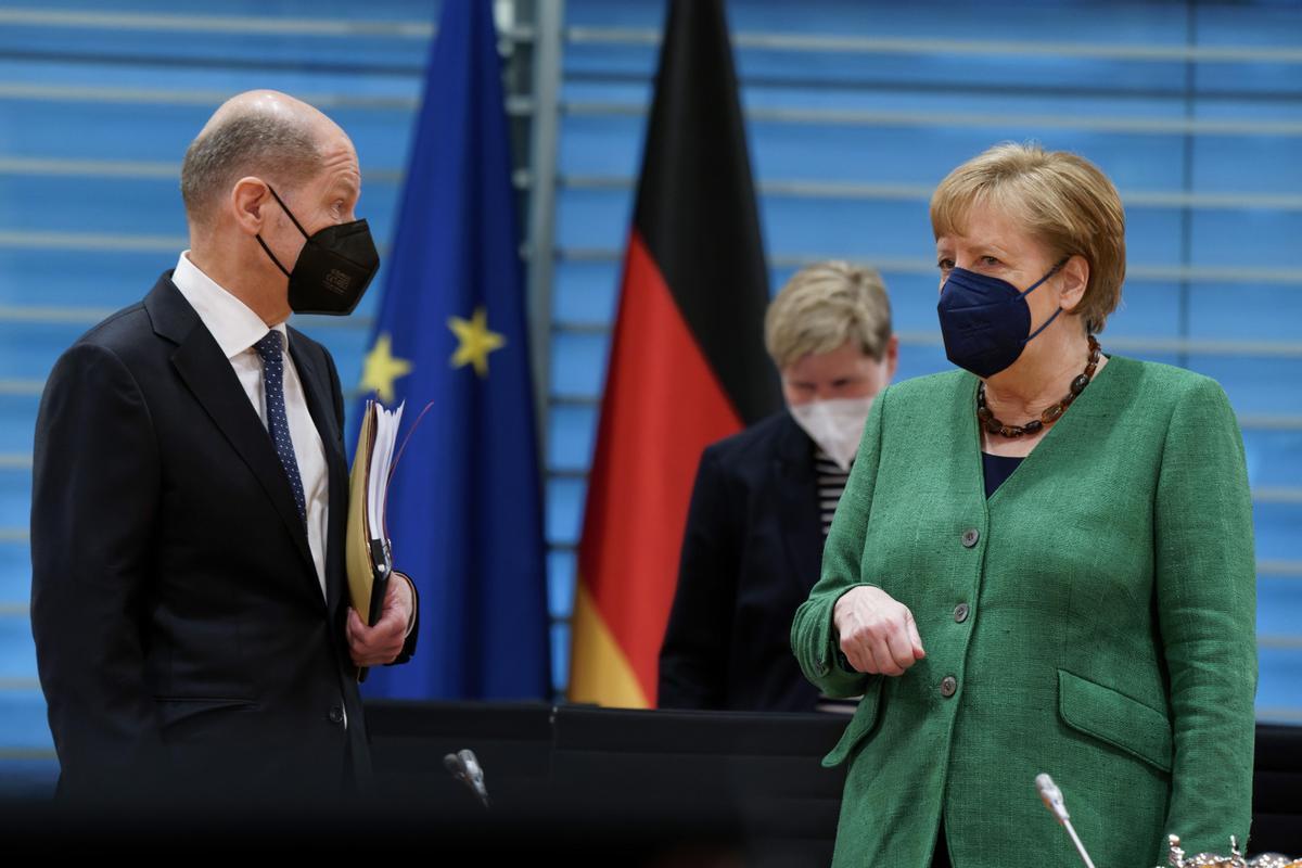 Olaf Scholz y Angela Merkel en Berlín, los dirigentes de la gran coalición actual.