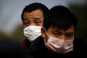 FILE PHOTO: People coming from the Hubei province wait at a checkpoint at the Jiujiang Yangtze River Bridge in Jiujiang, Jiangxi province, China, as the country is hit by an outbreak of a new coronavirus, February 1, 2020.  REUTERS/Thomas Peter - RC2JRE950YUT/File Photo