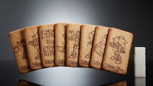 Galletas con dibujos infantiles y su equivalente en terrones de azúcar.