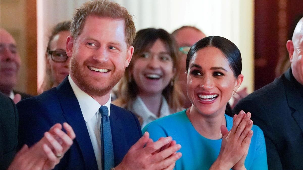 FILE PHOTO  Britain s Prince Harry and his wife Meghan  Duchess of Sussex  cheer during the annual Endeavour Fund Awards at Mansion House in London  Britain March 5  2020  Paul Edwards Pool via REUTERS File Photo