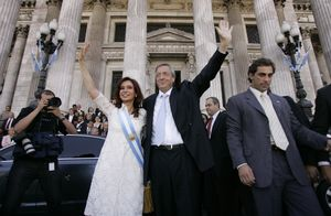 FILE - In this Dec. 10, 2007 file photo, Argentina's new president Cristina Fernandez, left, and her husband, Argentina's departing President Nestor Kirchner, wave after Fernandez was sworn in at the National Congress in Buenos Aires, Argentina.  According to state television in Argentina, Nestor Kirchner died on Wednesday Oct. 27, 2010 of a heart attack at age 60. (AP Photo/Jorge Saenz, File)
