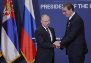 Russian President Vladimir Putin decorates Serbian President Alexandar Vucic with an order of Alexander Nevsky after their meeting in BelgradeSerbiaMaxim Shipenkov Pool via REUTERS