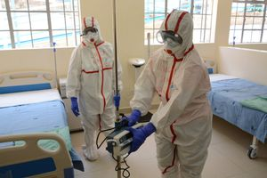 06 March 2020, Kenya, Nairobi: Staff of the coronavirus isolation ward of the hospital of Mbagathi are dressed in protective suits as they disinfects the hospital rooms. Photo: Dennis Sigwe/SOPA Images via ZUMA Wire/dpa