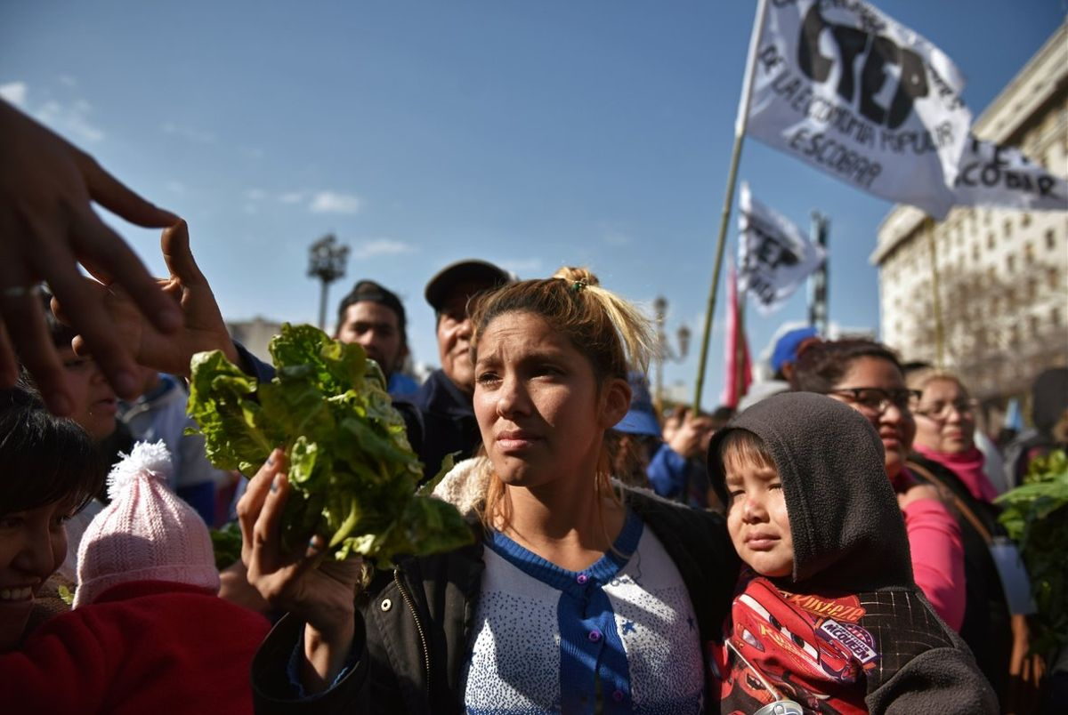 People receive free vegetables while protesting social conditions during the day of Saint Cajetan  the patron saint of Argentina and labour  in Buenos Aires  Argentina August 7  2019  REUTERS Pablo Stefanec NO RESALES  NO ARCHIVES