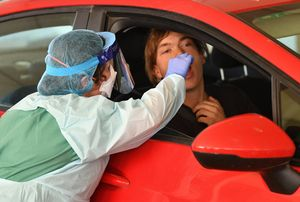 South Australia Hospital staff simulate a drive through coronavirus testing at the Repatriation Hospital in Adelaide, Tuesday, March 10, 2020. (AAP Image/David Mariuz) NO ARCHIVING