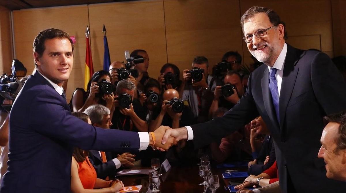 Albert Rivera y Mariano Rajoy, en la ratificación del acuerdo entre sus partidos en el Congreso.