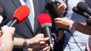 Unos periodistas, durante una entrevista.