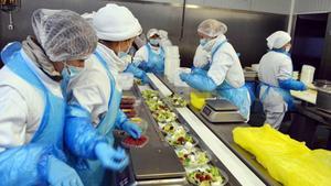 Trabajadores de Home Meal Replacement.