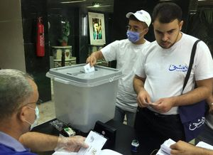 A man wearing a face mask casts his vote inside a polling station during the parliamentary elections in Damascus, Syria July 19, 2020. REUTERS/Omar Sanadiki