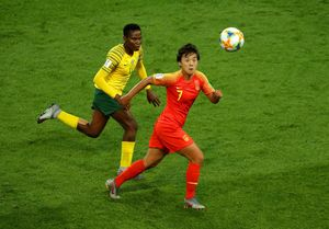PARIS, FRANCE - JUNE 13: Shuang Wang of China is challenged by Noko Matlou of South Africa during the 2019 FIFA Women's World Cup France group B match between South Africa and China PR at Parc des Princes on June 13, 2019 in Paris, France. (Photo by Richard Heathcote/Getty Images)