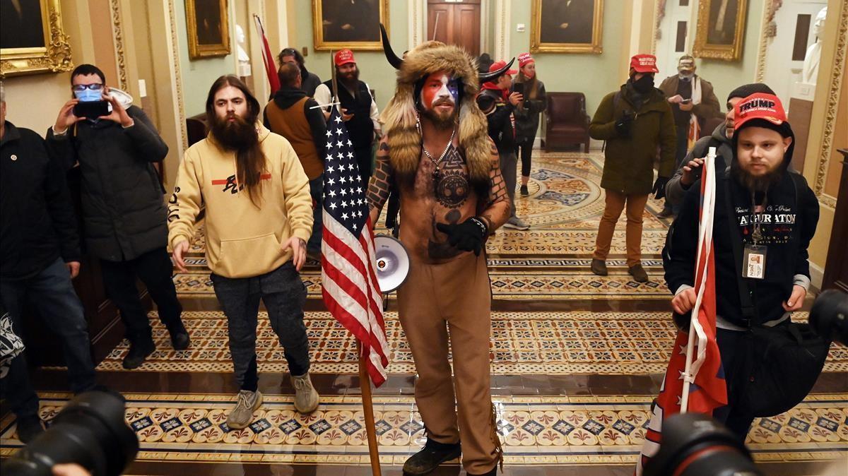 Manifestantes pro-Trump en el asalto al Capitolio.