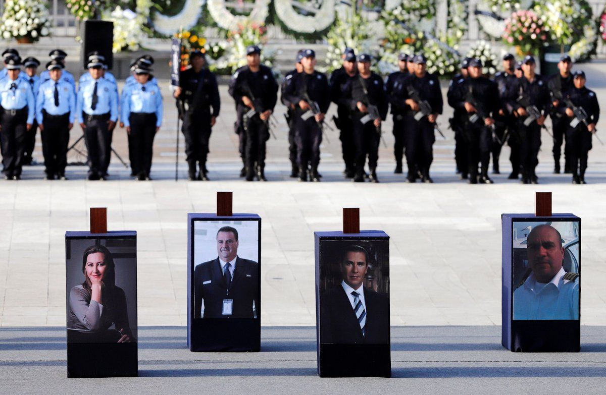 Urns with ashes of Martha Erika Alonsoa senior opposition figure and governor of the state of Pueblaher husband Rafael Moreno a senator and former Puebla governorand two crew members are displayed over their photographs during a homage in Puebla2018REUTERS Imelda Medina