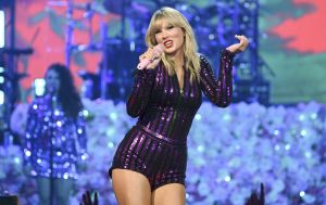 FILE - In this July 10, 2019 file photo, singer Taylor Swift performs at Amazon Music's Prime Day concert at the Hammerstein Ballroom in New York City. Swift, who has won 23 American Music Awards, is up for five awards this year including artist of the year and could surpass the King of Pop, who holds the record for most wins with 24 trophies. The fan-voted AMAs will air live on Nov. 24.  (Photo by Evan Agostini/Invision/AP, File)